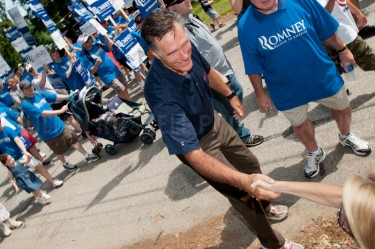 Presidential hopefuls Mitt Romney and Jon Huntsman march in a 4th of July parade in Amherst, NH.