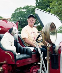 Fireman and dog in antique truck
