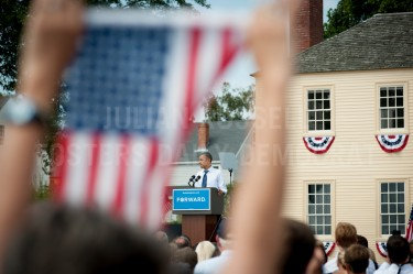 Framed by an american flag President Barack Obama speaks from the podium during a campaign rally at Strawberry Banke in Portsmouth on Friday.