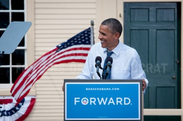 President Barack Obama speaks from the podium during a campaign rally at Strawberry Banke in Portsmouth on Friday.
