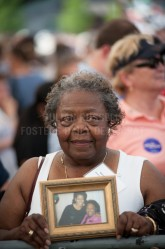 Vernis Jackson of Portsmouth holds a photo of her and Michelle Obama at a campaign rally for president Barack Obama held at Strawberry Banke in Portsmouth on Friday.
