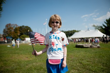 Rilley Brooks, 8, of Hanover wearing one of the many shirts she designed, made and donated proceeds to the campaign to re-elect Barack Obama at a rally for the president held at Strawberry Banke in Portsmouth on Friday.