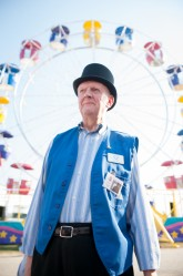 Rochester Fair Ambassador & Voice Joel Sherburne stands opens the Rochester Fair in style with a top hat in front of a Ferris wheel at the Rochester Fairgrounds on Friday.