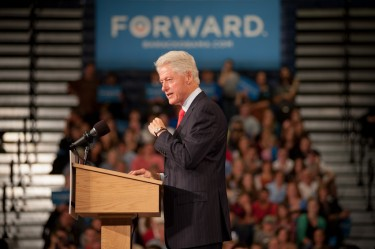 Former president Bill Clinton addresses supporters at a campaign rally for Barack Obama at UNH in Durham on Wednesday.