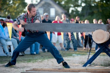 The Paul Bunyan Lumberjack Show performs with a cross saw at the Rochester Fair on Sunday.