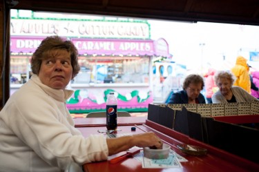 Paulette Welch keeps an eye on the board while playing Bingo Tuesday afternoon at the Rochester Fair.