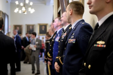 Military officers line the halls of the New Hampshire statehouse waiting to join governor-elect  Maggie Hassan's procession into the House Chamber to be inaugurated governor on January 3rd in Concord.
