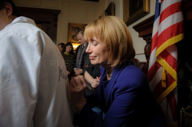 New Hampshire governor Maggie Hassan autographs a shirt during a receiving line  at the statehouse in Concord on January 3rd.